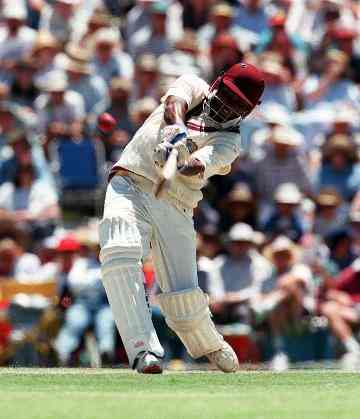 Windies captain Brian Lara drives for four